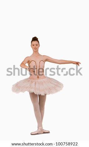 Ballerina preparing to spin against a white background