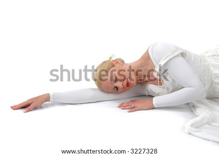 Ballerina resting on her arm on a white background