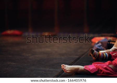 Ballerina sitting on the scene before perfomance