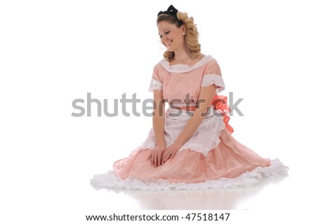 Ballerina wearing a pink dress and isolated on a white background