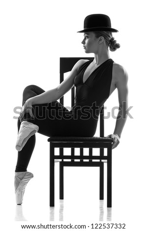 Ballet dancer girl sitting on the chair. Isolated - stock photo
