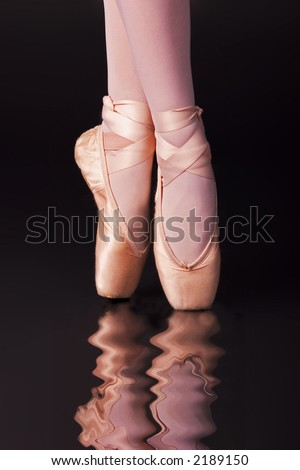 Ballet dancer's feet - stock photo