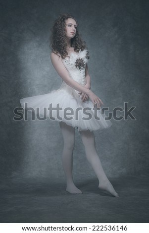 Ballet fashion style brunette woman. Wearing white corset and dress.
