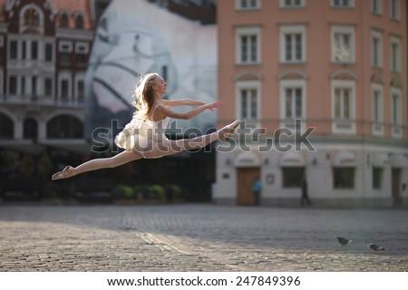 Ballet split leap at the street - stock photo