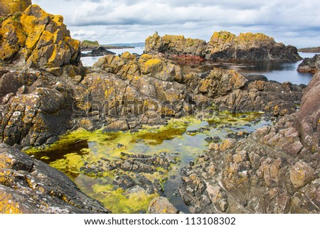Ballintoy bay in Northern Ireland small basalt isles and rock formations of various kinds rise out of the atlantic ocean - stock photo