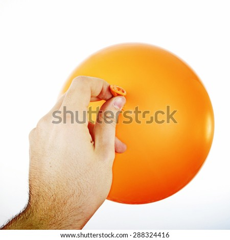 Ballon in a man's hand isolated.