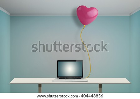 Balloon heart-shaped connected to the laptop with a network cable