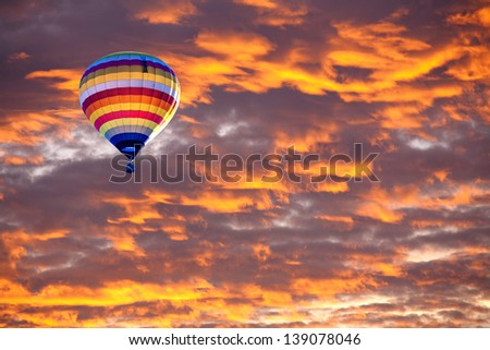 Balloon on Sunset / sunrise with clouds, light rays and other atmospheric effect - stock photo