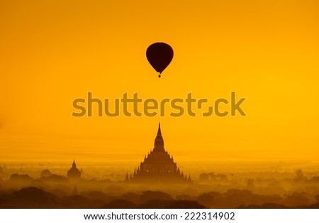 Balloon over plain of Bagan in misty morning, Myanmar - stock photo