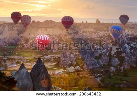 Balloons flying in beams on rising. - stock photo