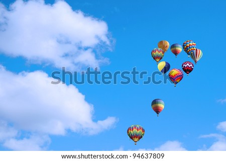 balloons gathered in the sky in the shape of a heart. - stock photo