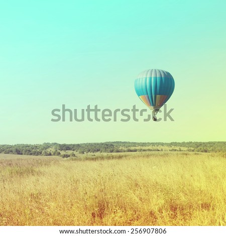 Balloons in the sky at sunrise. Vintage retro style - stock photo