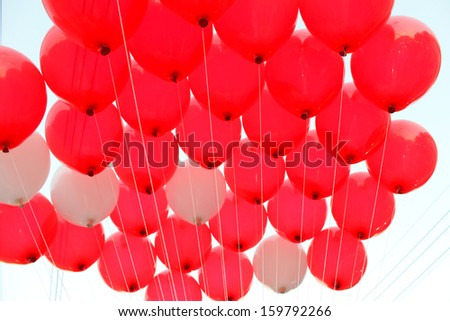 Balloons of many on blue sky  - stock photo