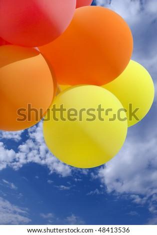 Balloons on blue sky - stock photo