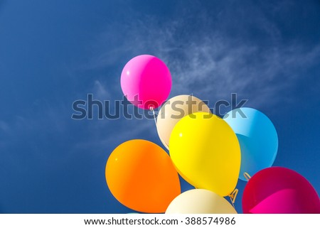 Balloons over a clear blue sky. - stock photo