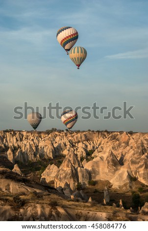 Balloons over valley in Cappadocia in the morning. Vertical shot.