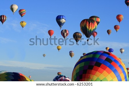 Balloons rising in the morning sun