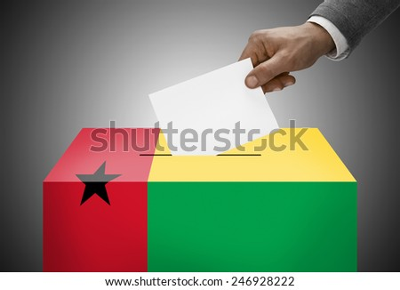 Ballot box painted into national flag colors - Guinea-Bissau - stock photo