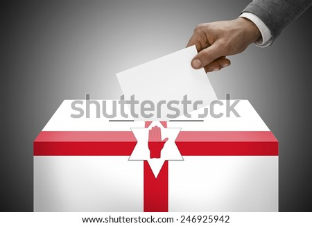 Ballot box painted into national flag colors - Northern Ireland - stock photo