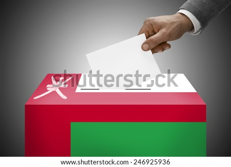 Ballot box painted into national flag colors - Oman - stock photo