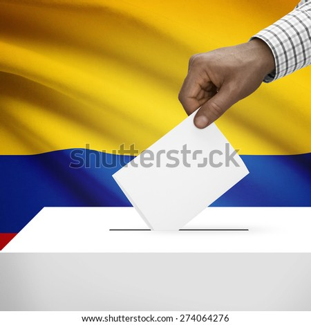 Ballot box with flag on background - Colombia - stock photo