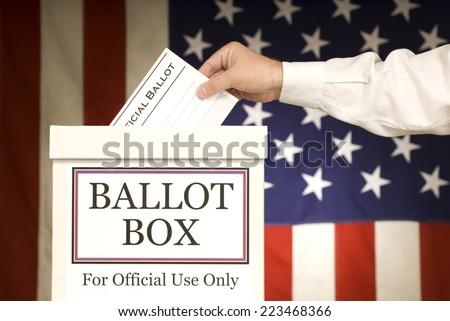 Ballot Box With Hand Voting/ Horizontal Shot - stock photo