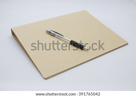 Ballpoint pen and notebook white back