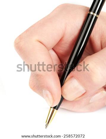 Ballpoint pen in female hand isolated on white - stock photo