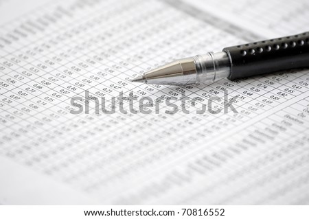 Ballpoint Pen on table with numbers - stock photo