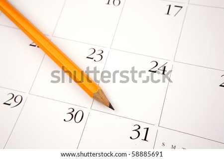 Ballpoint pencil on calendar page - stock photo