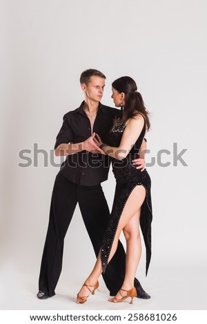 Ballroom dancing. Man and woman posing in dance pose on white. Man and woman dancing ballroom dances. Beautiful man and woman doing the dance steps. Dance poses.