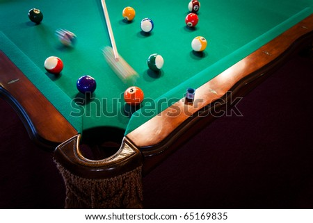 balls and the cue on the pool table - stock photo