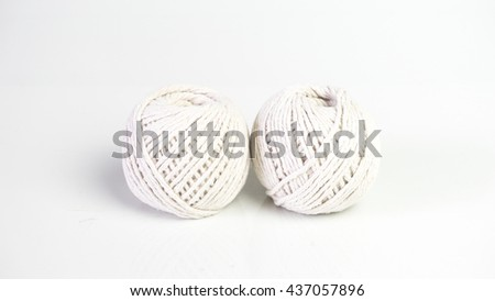 Balls of baumwolle yarn cotton wool. Isolated on empty background. Slightly de-focused and close-up shot. Copy space. - stock photo