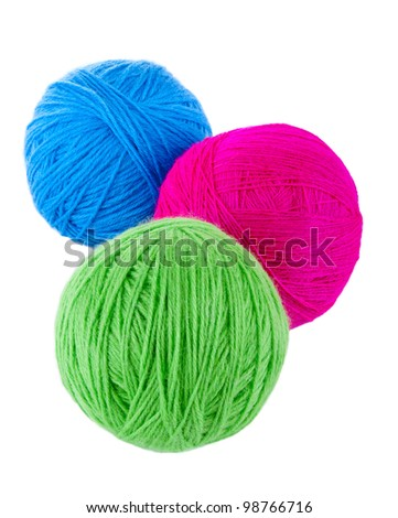 Balls of blue, red and green wool isolated on a white background