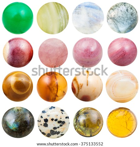 balls of natural mineral gemstones Onyx, aventurine, onyx, moonstone, aquamarine, mookaite, rose quartz, rhodonite, agate, labradorite, aplite, jade, tourmaline, fire opal isolated on white background - stock photo