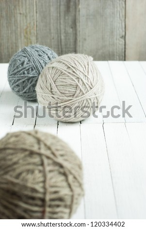 balls of wool on white wooden - stock photo