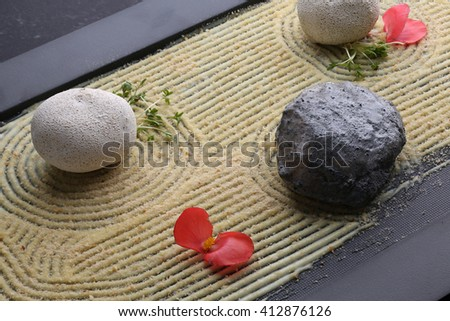 Balls potatoes and fish in clay served on mash, dark background - stock photo