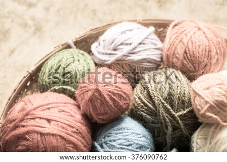 balls wool on wooden table background/toned photo - stock photo