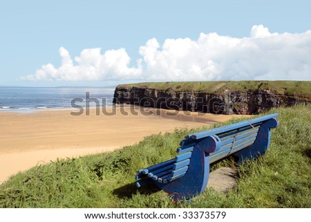 ballybunion bench with view of beach and cliffs - stock photo