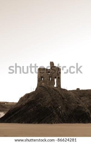ballybunion castle on the rocks in the west coast of ireland in sepia - stock photo