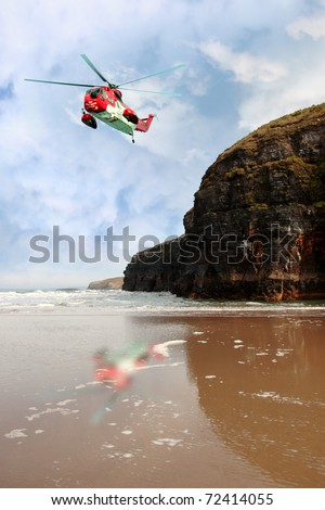BALLYBUNION,IRELAND-MARCH 2: Irish sea rescue helicopter searches for missing person near cliffs on March 2,2011 in Ballybunion, county Kerry, Ireland. The cliffs are often used in suicide attempts.