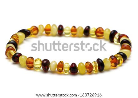 Baltic amber bracelet, multicolor model - stock photo