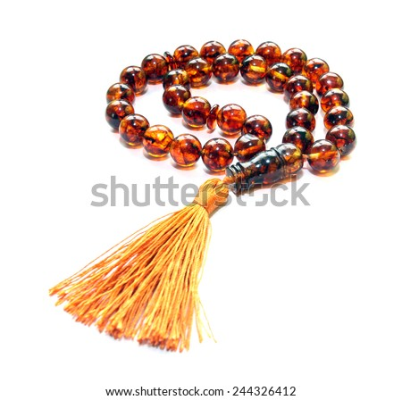 Baltic amber islamic rosary isolated on white  - stock photo