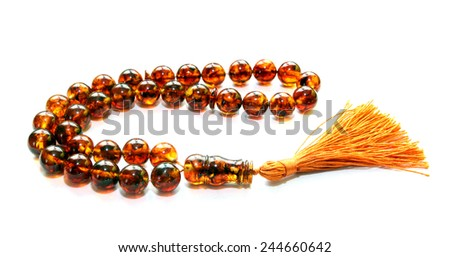 Baltic amber islamic rosary isolated on white