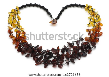 Baltic amber rough necklace, rainbow model - stock photo