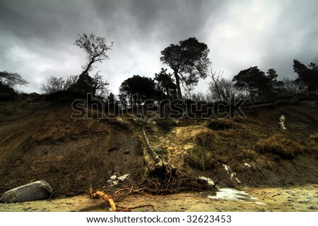 Baltic coast with eroded beach and landslide after storm - stock photo