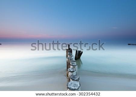 Baltic Sea and breakwater. Long exposure - stock photo