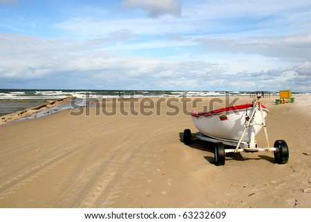 Baltic sea and single rescue boat  in Palanga, main resort in Lithuania - stock photo