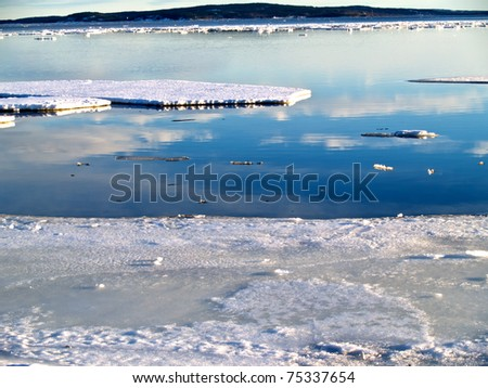 Baltic sea becoming free of ice, Sundsvall, northern Sweden - stock photo