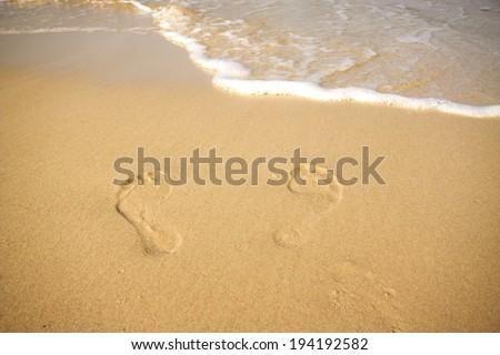 Baltic Sea, Poland/ Footprints on the beach. - stock photo